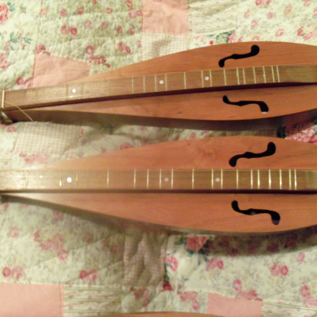 A pair of my dulcimers in Black Walnut and cherry.
